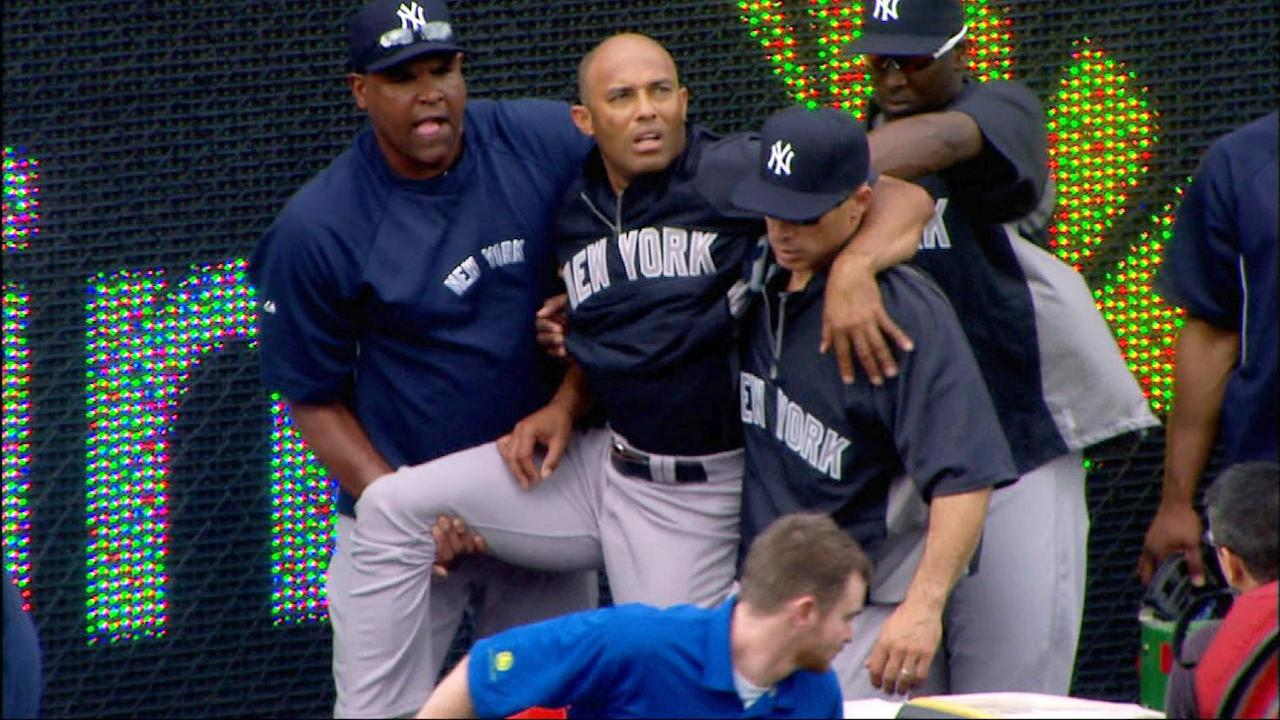 In this image taken from video, New York Yankees manager Joe Girardi, right, helps Mariano Rivera, top center, after Rivera twisted his right knee shagging fly balls during batting practice before a baseball game with the Kansas City Royals, Thursday, May 3, 2012, in Kansas City, Mo. The Yankees closer was carted off the field and sent for further tests. (AP Photo/YES Network) MANDATORY CREDIT