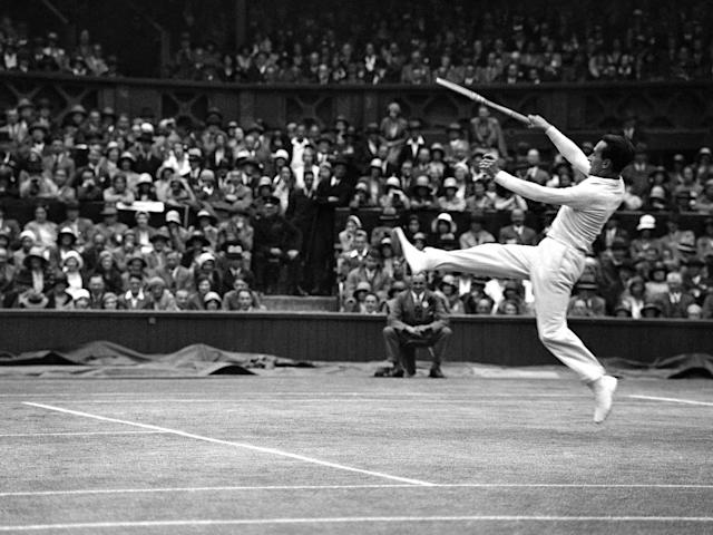 French tennis player Henri Cochet leaps during the Menís Doubles Final at Wimbledon, London on July 4, 1931. His partner was compatriot Jacques Brugnon and the opposition were American players George Lott and John van Ryn. (AP Photo)