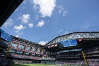 Two F-16 jets fly over Globe Life Field before a baseball game between the Texas Rangers and the Toronto Blue Jays Monday, April 5, 2021, in Arlington, Texas. The Texas Rangers are set to have the closest thing to a full stadium in pro sports since the coronavirus shut down more than a year ago. (AP Photo/Jeffrey McWhorter)