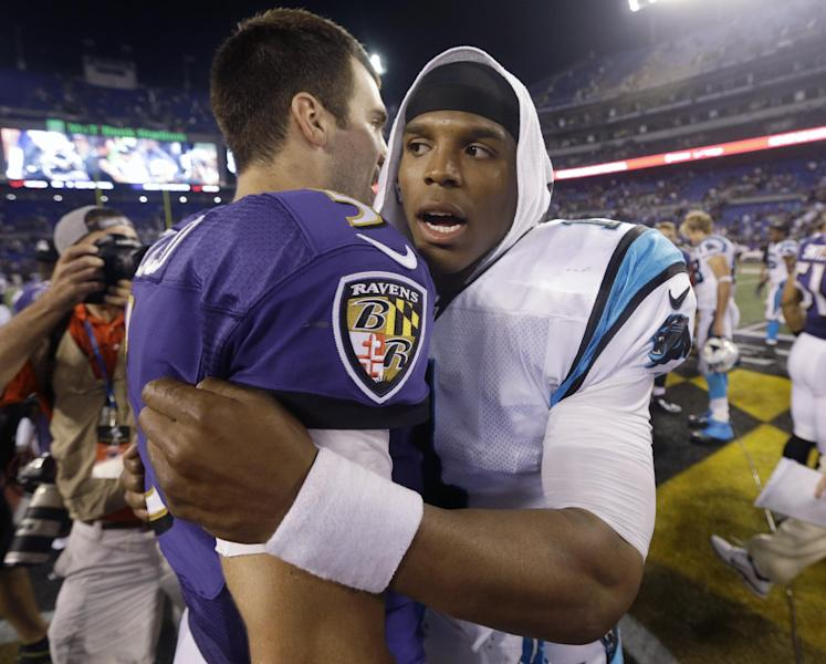 Carolina Panthers quarterback Cam Newton greets Baltimore Ravens quarterback Joe Flacco, left, at midfield after a preseason NFL football game in Baltimore, Thursday, Aug. 22, 2013. The Panthers defeated the Ravens 34-27. (AP Photo/Patrick Semansky)