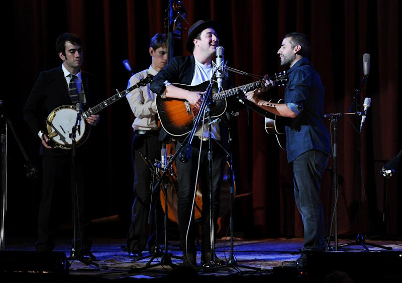 """Musicians Marcus Mumford, center, and Oscar Isaac, right, perform with members of the Punch Brothers during """"Another Day, Another Time: Celebrating the Music of Inside Llewyn Davis"""" at The Town Hall on Sunday, Sept. 29, 2013 in New York. (Photo by Evan Agostini/Invision/AP)"""