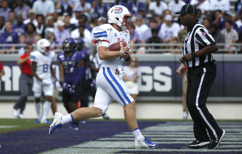 SMU quarterback Shane Buechele (7) carries the ball into the end zone for a touchdown against TCU during the first half of an NCAA college football game Saturday, Sept. 21, 2019, in Fort Worth, Texas. (AP Photo/Ron Jenkins)