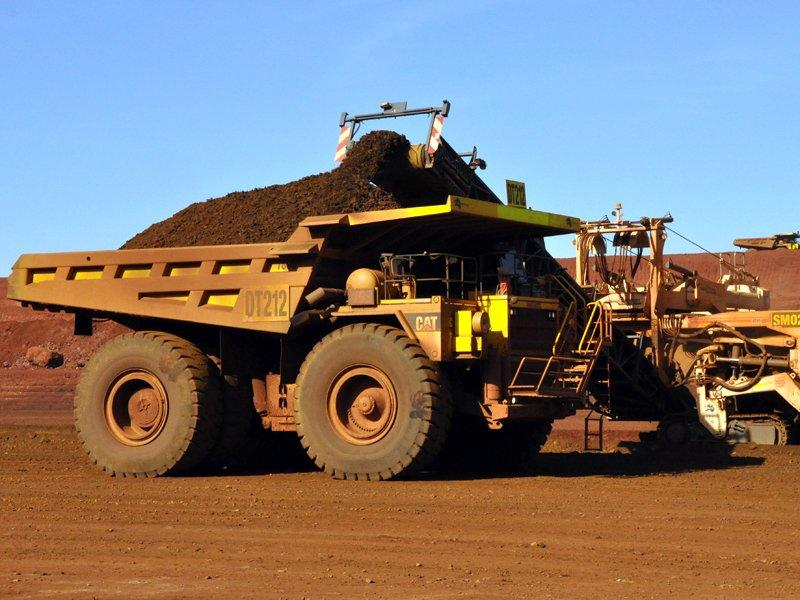 Fortescue profit falls, cuts dividend