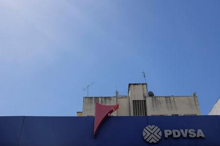 FILE PHOTO: The corporate logo of the Venezuelan state-owned oil company PDVSA is seen at a gas station in Caracas, Venezuela November 2, 2018.  REUTERS/Marco Bello/File Photo