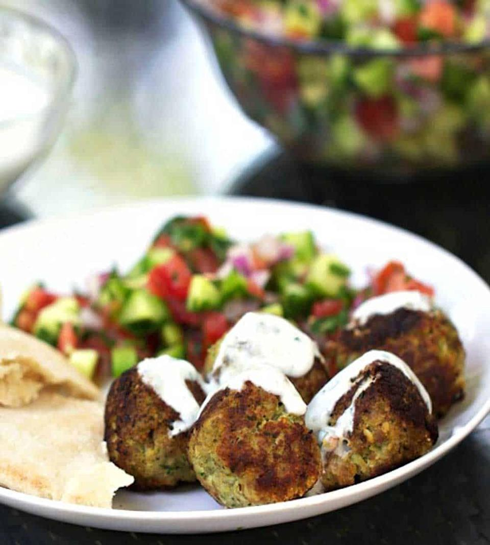 """<p>Serve these meatballs with a side of veggies and hummus, and you're in Mediterranean heaven. </p><p><a class=""""link rapid-noclick-resp"""" href=""""https://www.panningtheglobe.com/turkey-falafel-meatballs-with-lemon-yogurt-sauce/"""" rel=""""nofollow noopener"""" target=""""_blank"""" data-ylk=""""slk:GET THE RECIPE"""">GET THE RECIPE</a> </p><p><em>Per serving: 338 calories, 19.1 g fat (3.6 g saturated), 732.6 mg sodium, 20.6 g carbs, 3.6 g fiber, 4.9 g sugar, 22 g protein</em></p>"""
