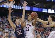 <p>Arizona guard Allonzo Trier (35) goes to the basket as Saint Mary's Dane Pineau (22) and Evan Fitzner, right, defend during the first half of a second-round college basketball game in the men's NCAA Tournament, Saturday, March 18, 2017, in Salt Lake City. (AP Photo/Rick Bowmer) </p>