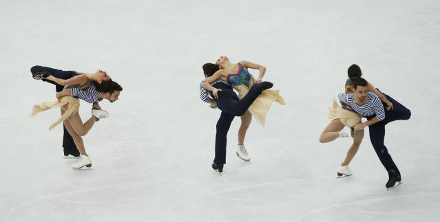 Spain's Sara Hurtado and Adria Diaz compete during the Figure Skating Ice Dance Free Dance Program at the Sochi 2014 Winter Olympics, February 17, 2014. Picture is taken with multiple exposure. REUTERS/Marko Djurica (RUSSIA - Tags: SPORT FIGURE SKATING SPORT OLYMPICS)