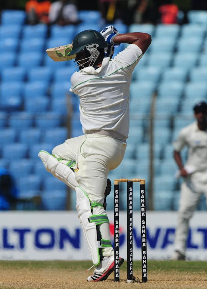 Bangladesh batsman Tamim Iqbal plays a shot during the fifth and final day of the first cricket Test match between Bangladesh and New Zealand at The Zahur Ahmed Chowdhury Stadium in Chittagong on October 13, 2013. AFP PHOTO/Munir uz ZAMAN        (Photo credit should read MUNIR UZ ZAMAN/AFP/Getty Images)