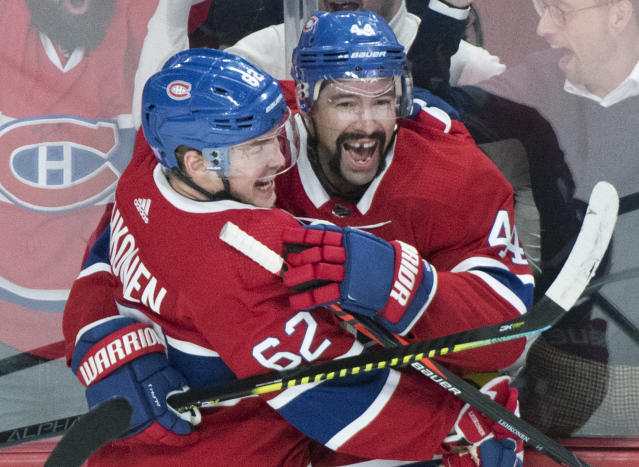 Montreal Canadiens' Nate Thompson, right, celebrates with Artturi Lehkonen after scoring against the Los Angeles Kings during the first period of an NHL hockey game Saturday, Nov. 9, 2019, in Montreal. (Graham Hughes/The Canadian Press via AP)