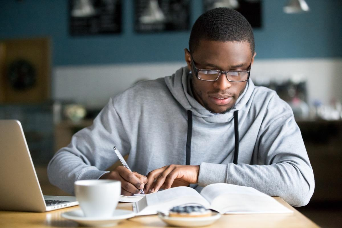 """During college, a hoodie emblazoned with your school's logo or name written in block letters is an unofficial uniform that screams """"I belong."""" Keep wearing it after you graduate and leave campus, however, and it says something more akin to """"I can't move on."""" So, unless you're still in college, it's time to donate the hoodie."""