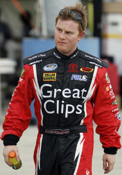 FILE - In this July 10, 2008, file photo, Jason Leffler walks to his garage before practice for the NASCAR Nationwide Series auto race at Chicagoland Speedway in Joliet, Ill. Kasey Kahne and Tony Stewart are entering next month's Chili Bowl Nationals in honor of the late racer Leffler. Kahne will drive a car entered in combination with Stewart; Leffler's girlfriend, Julianna Patterson; and former father-in-law, Bob East, in the Jan. 14-18 race at the Tulsa Expo Center in Oklahoma. (AP Photo/Nam Y. Huh, File)