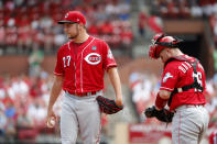 Cincinnati Reds starting pitcher Trevor Bauer, left, stands on the mound as catcher Tucker Barnhart comes out to talk after an RBI double by St. Louis Cardinals' Yadier Molina during the first inning in the first baseball game of a doubleheader Saturday, Aug. 31, 2019, in St. Louis. (AP Photo/Jeff Roberson)