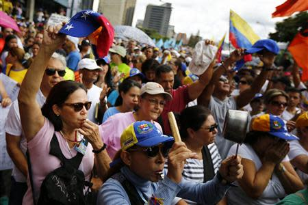 Opposition supporters march during a protest in Caracas against inflation and shortages