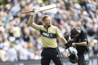 New Zealand batsman Martin Guptill waves to the crowd as he leaves the field after he was dismissed for 97 runs during the second T20 cricket international between Australia and New Zealand at University Oval In Dunedin, New Zealand, Thursday, Feb. 25, 2021. (Andrew Cornaga/Photosport via AP)