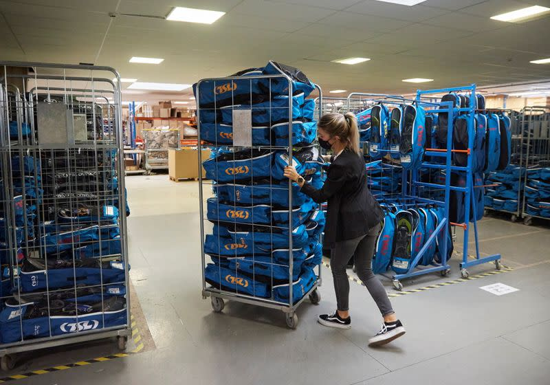A staff member moves a cart with finished products at world biggest snowshoes maker TSL in Annecy-le-Vieux