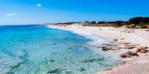 """<p>Ibiza has plenty of must-see beaches, including <a href=""""https://www.tripadvisor.com/ShowUserReviews-g664638-d2336467-r132309367-Platja_d_es_Cavallet-Ibiza_Town_Ibiza_Balearic_Islands.html"""" rel=""""nofollow noopener"""" target=""""_blank"""" data-ylk=""""slk:Es Cavallet Beach"""" class=""""link rapid-noclick-resp"""">Es Cavallet Beach</a>, a long, sandy stretch surrounded by sand dunes, where, on a clear day, you can see the neighboring island of Formentera. Keep in mind that Es Cavallet is one of the island's nude beaches!</p><p><a class=""""link rapid-noclick-resp"""" href=""""https://go.redirectingat.com?id=74968X1596630&url=https%3A%2F%2Fwww.tripadvisor.com%2FHotel_Review-g664638-d12439895-Reviews-Sir_Joan_Hotel-Ibiza_Town_Ibiza_Balearic_Islands.html&sref=https%3A%2F%2Fwww.redbookmag.com%2Flife%2Fg34756735%2Fbest-beaches-for-vacations%2F"""" rel=""""nofollow noopener"""" target=""""_blank"""" data-ylk=""""slk:BOOK NOW"""">BOOK NOW</a> Sir Joan Hotel</p>"""