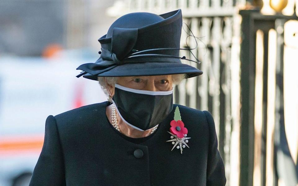 Britain's Queen Elizabeth II arrives for a ceremony to mark the centenary of the burial of the Unknown Warrior, in Westminster Abbey, London, Wednesday, Nov. 4, 2020. Queen Elizabeth II donned a face mask in public for the first time during the coronavirus pandemic when attending a brief ceremony at Westminster Abbey last week to mark the centenary of the burial of the Unknown Warrior. While the 94-year-old has been seen in public on several occasions over the past few months, she has not worn a face covering.  - Aaron Chown/AP