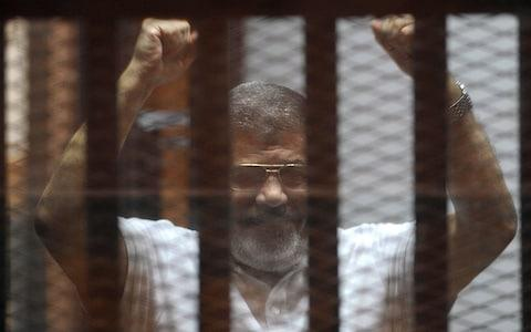 Mohammed Morsi pictured here in 2014 - Credit: Ahmed Almalky/Anadolu Agency/Getty Images