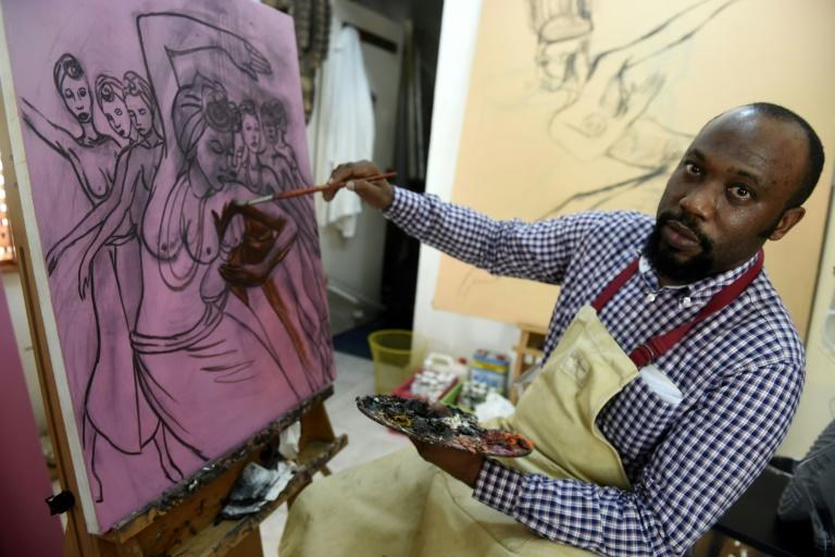 """In his Lagos studio, Oliver Enwonwu said: """"It's a thing of joy that several decades after his death my father's works are being appreciated globally"""""""