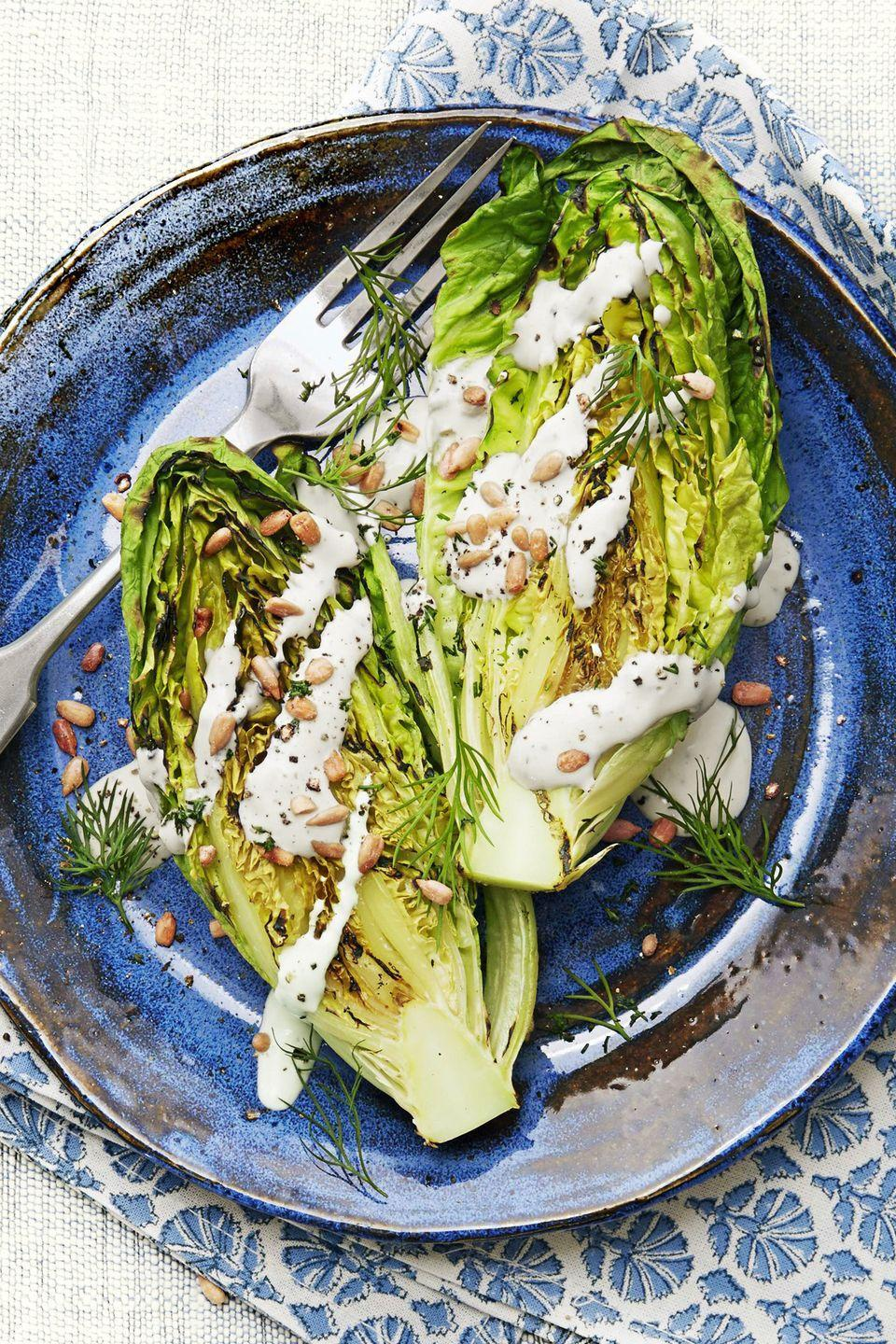 """<p>Reinvent a classic Caesar salad by throwing romaine lettuce hearts on the grill. </p><p><em><a href=""""https://www.goodhousekeeping.com/food-recipes/healthy/a45180/feta-dill-greek-caesar-recipe/"""" rel=""""nofollow noopener"""" target=""""_blank"""" data-ylk=""""slk:Get the recipe for Feta-Dill Greek Caesar Salad »"""" class=""""link rapid-noclick-resp"""">Get the recipe for Feta-Dill Greek Caesar Salad »</a></em></p><p><strong>RELATED: </strong><a href=""""https://www.goodhousekeeping.com/food-recipes/cooking/g532/types-of-lettuce/"""" rel=""""nofollow noopener"""" target=""""_blank"""" data-ylk=""""slk:11 Types of Lettuce to Try So You'll Never Have a Boring Salad Again"""" class=""""link rapid-noclick-resp"""">11 Types of Lettuce to Try So You'll Never Have a Boring Salad Again</a></p>"""