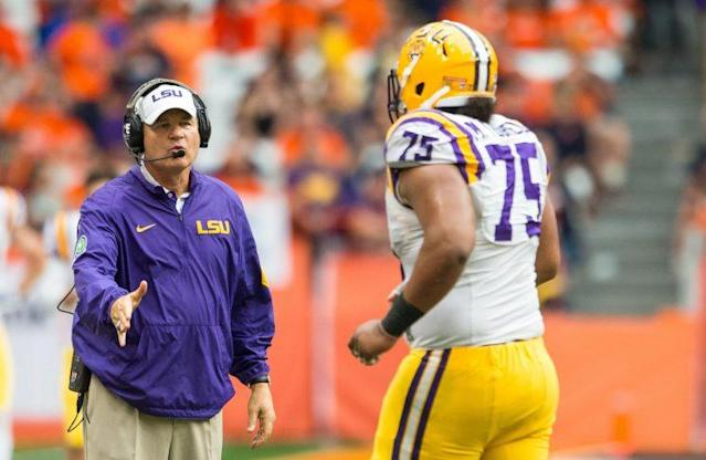 Teuhema, seen here in 2015 with former LSU coach Les Miles, has been a two-year starter for the Tigers. (Getty)