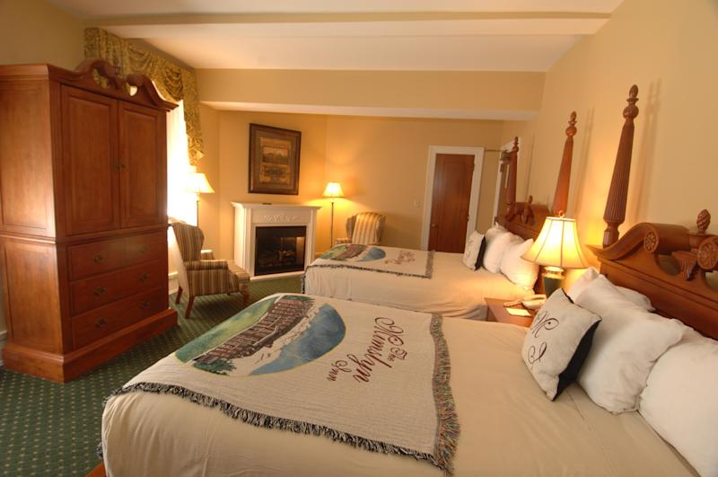 This undated photo provided by The Mimslyn Inn in Luray, Va., shows a guest room at the 82-year-old inn, which was closed for a year in 2007 while undergoing a $3.5 million renovation, including a complete mechanical and cosmetic upgrade. It's important to do your homework when planning a stay at a historic hotel or inn, because while some like The Mimslyn have modernized, others may count on their history or location to appeal to guests who don't mind rustic or old-fashioned accommodations. (AP Photo/Mimsyln Inn)