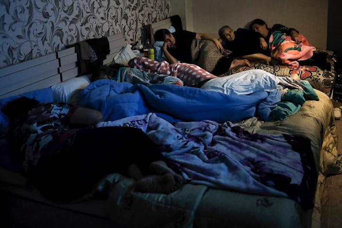 People watching TV in bomb shelter during Nagorno-Karabakh conflict