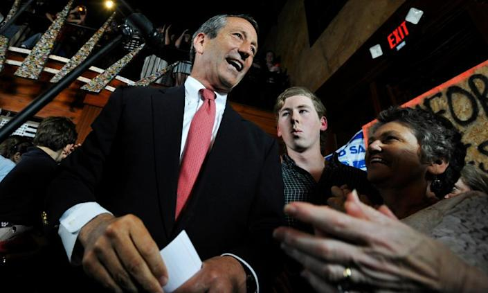 Mark Sanford, left, gives his victory speech after winning back his old congressional seat in the state's first district on 7 May 2013, in Mt Pleasant, South Carolina.