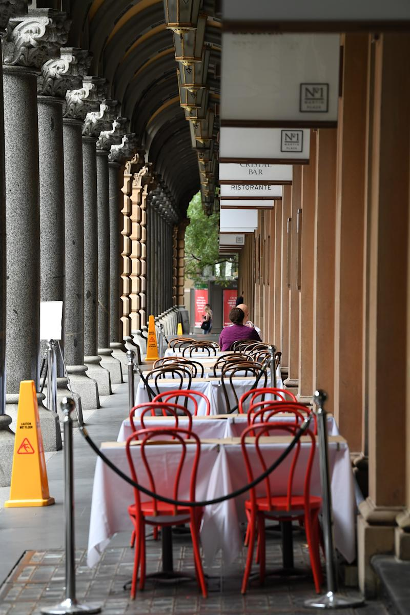 Empty outdoor cafes in the Sydney CBD as NSW rolls out a comprehensive shutdown. Source: Getty Images