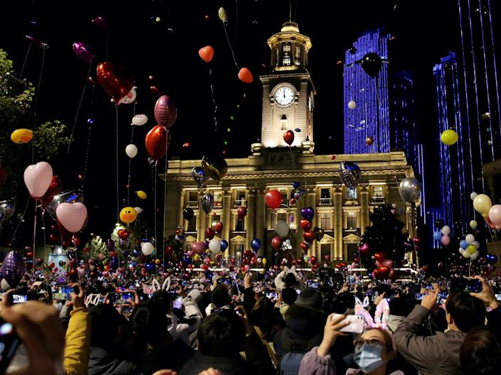 People celebrate the arrival of the new year in Wuhan, China. December 31, 2021.