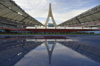 The Morodok Techo National Stadium is seen during a ceremony to hand it over to the Cambodian organizing committee of the Southeast Asian Games, in Phnom Penh, Cambodia, Sunday, Sept. 12, 2021. China's Foreign Minister Wang Yi, who attended the ceremony Sunday, met with Prime Minister Hun Sen and other officials to discuss COVID-19 and other regional issues. (Tang Chhin Sothy/Pool Photo via AP)