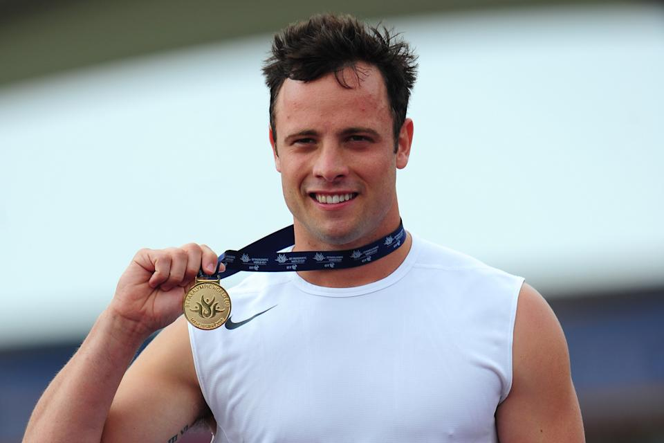 South Africa's Oscar Pistorius with his gold medal from the T44 100m