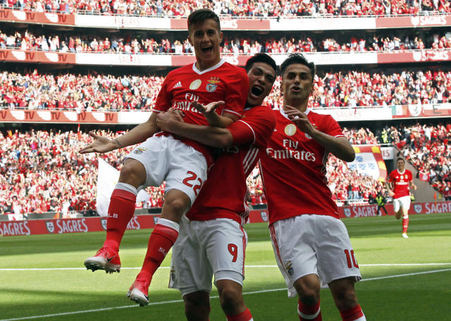 <p>Benfica's Franco Cervi, left, celebrates with teammates Raul Jimenez and Jonas, right, after scoring the opening goal during a Portuguese league soccer match between Benfica and Vitoria de Guimaraes at the Luz stadium in Lisbon, May 13, 2017. (Photo: Pedro Rocha/AP) </p>