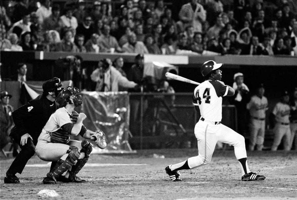 Atlanta Braves' Hank Aaron (44) breaks Babe Ruth's record for career home runs as he hits his 715th off Los Angeles Dodgers pitcher Al Downing in the fourth inning of the game opener at Atlanta-Fulton County Stadium, Ga., April 8, 1974. (AP Photo)