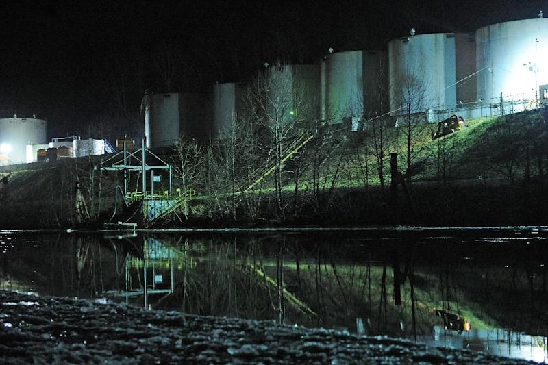 Crews clean up a chemical spill along the Elk River in Charleston, W.Va., which compromised the public water supply of eight counties on Thursday, Jan. 9, 2014. (AP Photo/Tyler Evert)