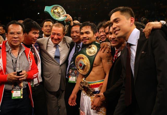 Pacquiao, centre right, produced arguably his finest performance to beat Miguel Cotto (Dave Thompson/PA)