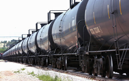 FILE PHOTO: A crude oil train moves past the loading rack at the Eighty-Eight Oil LLC's transloading facility in Ft. Laramie, Wyoming July 15, 2014. REUTERS/Rick Wilking