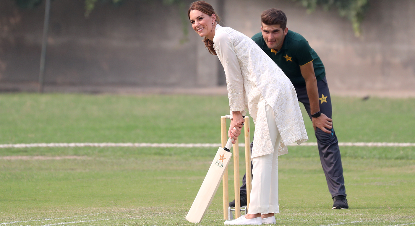 The Duchess of Cambridge wore affordable trainers whilst playing cricket during her visit at the National Cricket Academy. [Photo: Getty]