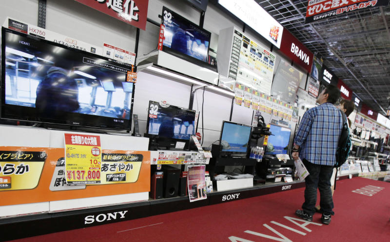 Customers visit a corner of Sony's Bravia flat-panel TVs at a Tokyo electronics store in Tokyo, Thursday, May 9, 2013. Sony Corp. is back in the black for the fiscal fourth quarter, recording a 93.9 billion yen ($948 million) profit, with big help from a weaker yen that boosts overseas earnings. (AP Photo/Koji Sasahara)