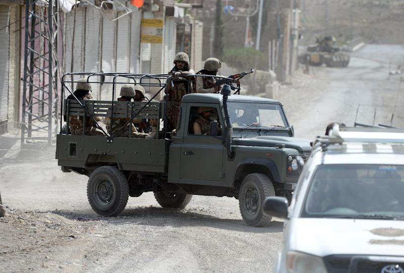 Pakistani soldiers patrol during a military operation against Taliban militants, in Miranshah, North Waziristan, on July 9, 2014