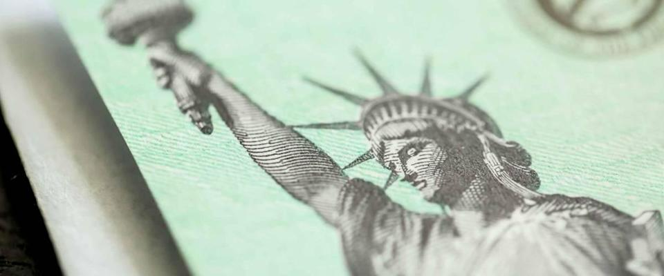 Extreme close-up of Federal coronavirus stimulus check provided to all Americans from the United States Treasury in 2020, showing the statue of liberty.