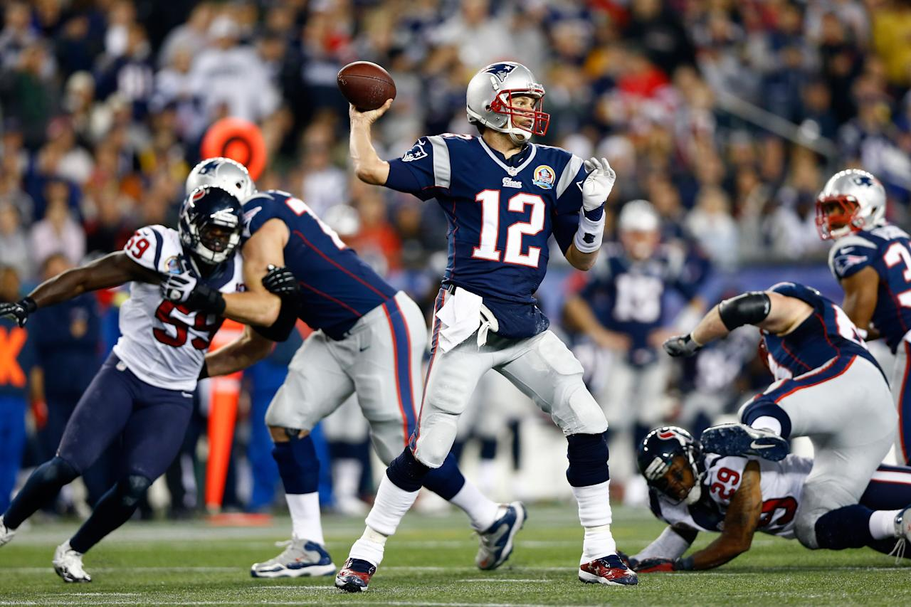 FOXBORO, MA - DECEMBER 10:  Quarterback Tom Brady #12 of the New England Patriots throws the ball in the first half against the Houston Texans at Gillette Stadium on December 10, 2012 in Foxboro, Massachusetts.  (Photo by Jared Wickerham/Getty Images)