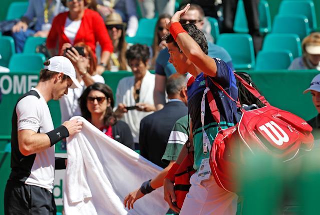 Tennis - Monte Carlo Masters - Monaco, 15/04/2016. Milos Raonic of Canada (R) leaves the court after being defeated by Andy Murray of Britain. REUTERS/Eric Gaillard