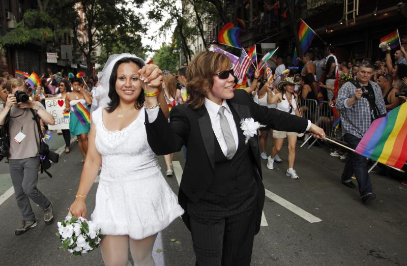 Paola Perez, left, and her partner Linda Collazo, march in the annual Gay Pride parade in Greenwich Village, Sunday, June 26, 2011 in New York. One of the world's oldest and largest gay pride parades was expected to become a victory celebration Sunday after New York's historic decision to legalize same-sex marriage.  The law signed by Gov. Andrew Cuomo on Friday doesn't take effect for 30 days. (AP Photo/Mark Lennihan) (AP Photo/Mark Lennihan)