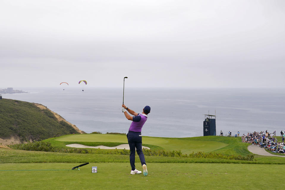Rory McIlroy, of Northern Ireland, plays his shot from the third tee during the third round of the U.S. Open Golf Championship, Saturday, June 19, 2021, at Torrey Pines Golf Course in San Diego. (AP Photo/Jae C. Hong)