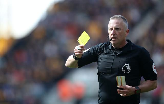 Yellow cards could be handed out for spitting (PA)