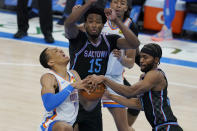 Sacramento Kings forward Maurice Harkless, right, knocks the ball away from Oklahoma City Thunder forward Darius Bazley (7) in front of teammate center Damian Jones (15) in the first half of an NBA basketball game Tuesday, May 4, 2021, in Oklahoma City. (AP Photo/Sue Ogrocki)