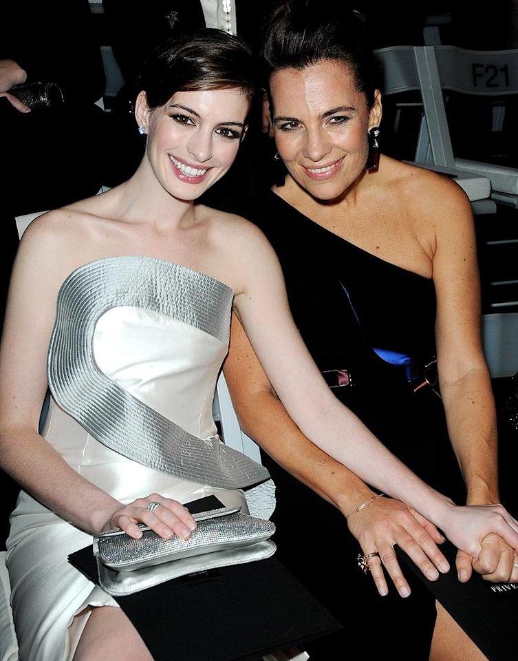 """Anne Hathaway got up close and personal with Giorgio's niece, Roberta Armani, at the Giorgio Armani Prive show in Paris. Showing her support for the fashion house, the actress was elegant in a white and silver Armani frock. Pascal Le Segretain/<a href=""""http://www.gettyimages.com/"""" target=""""new"""">GettyImages.com</a> - January 25, 2010"""