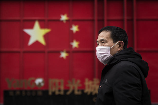 A man is pictured wearing a protective mask in Wuhan on 10 February. (Getty Images)