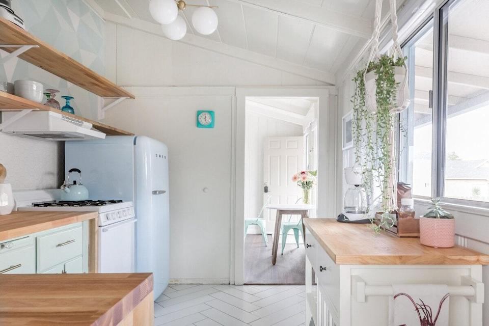 """<p>This quaint, 1930s bungalow has just enough room for a couple or a small family looking to spend some time near <a href=""""https://www.cntraveler.com/story/3-days-in-monterey-and-big-sur?mbid=synd_yahoo_rss"""" rel=""""nofollow noopener"""" target=""""_blank"""" data-ylk=""""slk:Monterey"""" class=""""link rapid-noclick-resp"""">Monterey</a>. Centrally located and in walking distance of both the beach and the Monterey Bay Coastal Rec Trail, it's also a short drive from all the major attractions (when open, the <a href=""""https://www.cntraveler.com/activities/monterey/monterey-bay-aquarium?mbid=synd_yahoo_rss"""" rel=""""nofollow noopener"""" target=""""_blank"""" data-ylk=""""slk:Monterey Bay Aquarium"""" class=""""link rapid-noclick-resp"""">Monterey Bay Aquarium</a> is a can't-miss). It's also just a short drive from a Safeway for stocking the kitchen's retro pale blue Smeg. The single bedroom has a queen-sized bed, and children's amenities like a Pack-n-Play, high chair, and baby bath are available if you need. The living room's smart TV has cable, Netflix, and HBO GO, so you can at least <a href=""""https://www.cntraveler.com/galleries/2015-01-07/50-best-travel-films-of-the-past-50-years?mbid=synd_yahoo_rss"""" rel=""""nofollow noopener"""" target=""""_blank"""" data-ylk=""""slk:watch movies about travel"""" class=""""link rapid-noclick-resp"""">watch movies about travel</a> if your outside-the-house adventures are still limited. There's also a back patio for grilling and evenings spent sitting by the fire pit.</p> <p><strong>Book now:</strong> <a href=""""https://airbnb.pvxt.net/6Jm9b"""" rel=""""nofollow noopener"""" target=""""_blank"""" data-ylk=""""slk:From $171 per night or $4,864 per month, airbnb.com"""" class=""""link rapid-noclick-resp"""">From $171 per night or $4,864 per month, airbnb.com</a></p>"""
